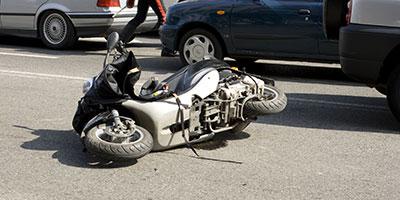 passenger-on-a-motor-scooter-injured