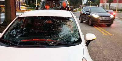 Vehicle damaged from Pedestrian hit by car